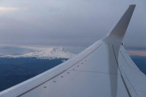 Mount Rainier at sunrise out a plane window.