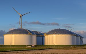 Giant modern oil storage tanks in an industrial harbor area with blue sky
