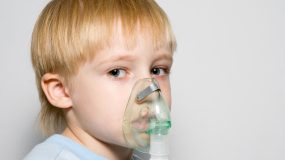 Child breathing through inhaler