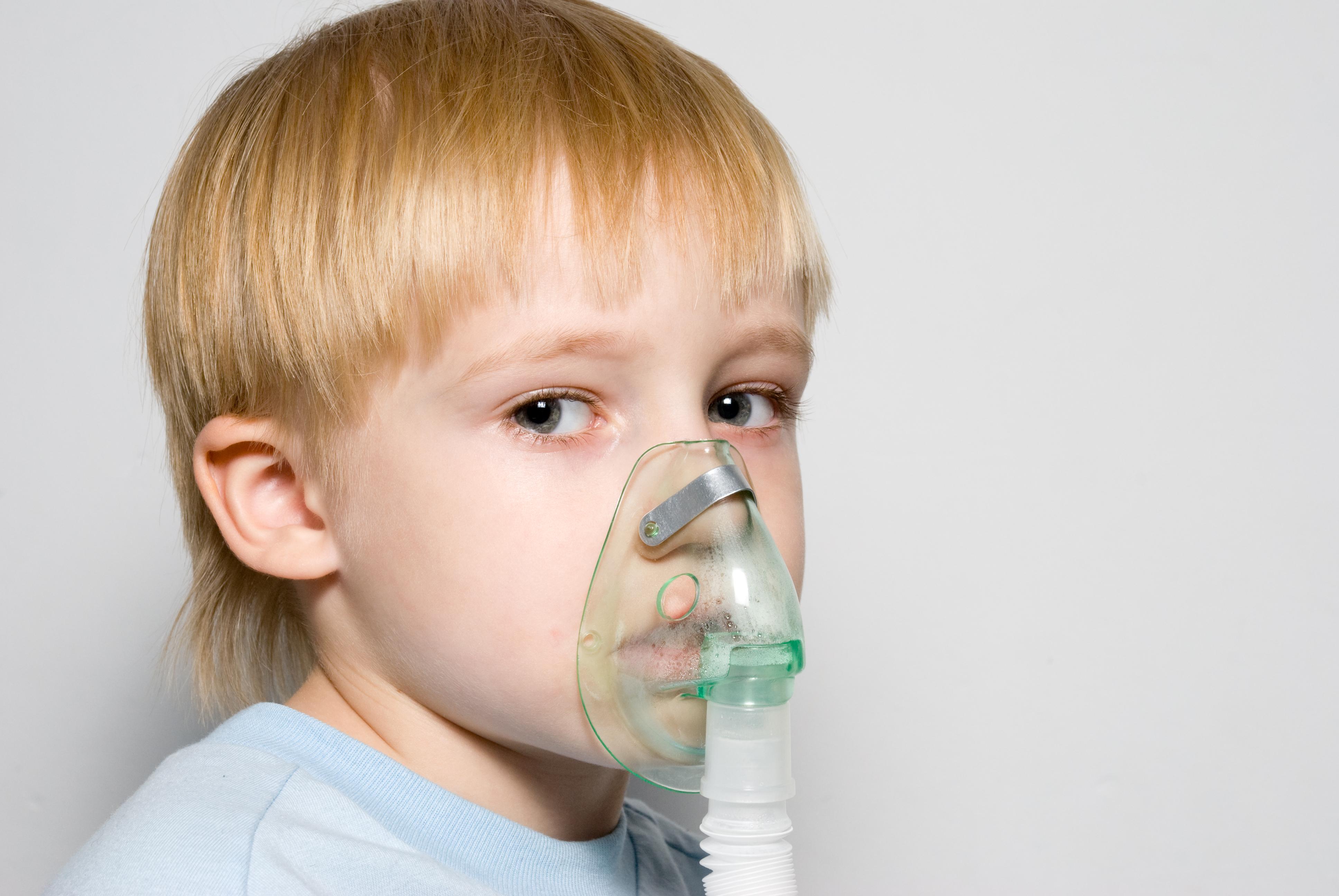 Child breathing through inhaler