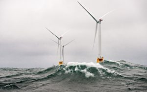 Heavy seas engulf the Block Island Wind Farm- the first US offshore wind farm. The five Halide 6MW turbines were installed by Deepwater Wind and began producing power in 2016. (Photo by Dennis Schroeder / NREL)