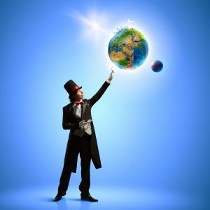 Image of magician in hat holding globe. Ecology concept. Elements of this image are furnished by NASA