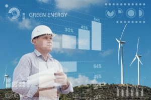 Engineer and a windfarm. Green energy concept.