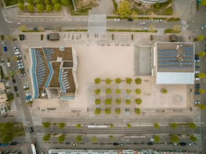 Aerial view of buildings with solar panels