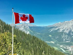 Canadian flag with mountains in background