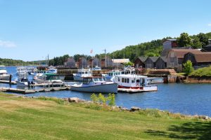 Harbour at Montague, Prince Edward Island, Canada with fishing boats, lobster traps and shacks along the pier
