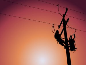 Silhouette of power lineman closing a single phase transformer