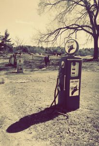 Vintage photo of horses and gasoline pump