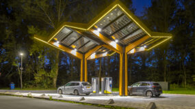 Electric cars charging at electricity filling station in the fast expanding car charging network in the Netherlands