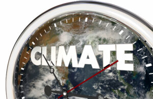 Illustration: Climate Change Clock Earth Hands Ticking