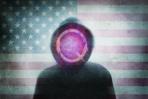 QAnon conspiracy theory concept. Of a hooded figure with the Q symbol. Over layered with the United States flag. with a blurred, grunge, abstract edit
