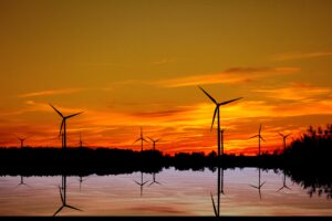 Sunset with wind turbines in the picture