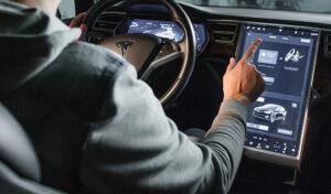 Inside Vew of Tesla Electric Vehicle. Sreering Wheel and Displays.