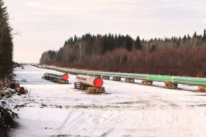 A long row of pipeline being pieced together.