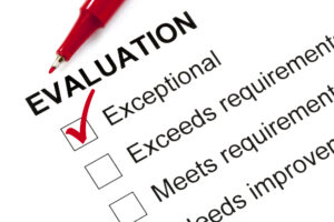 """Evaluation form marked """"exceptional"""" with red pen."""
